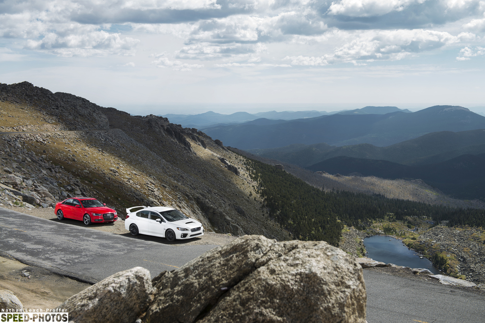 Landscape view of the mountains with Subaru and Audi