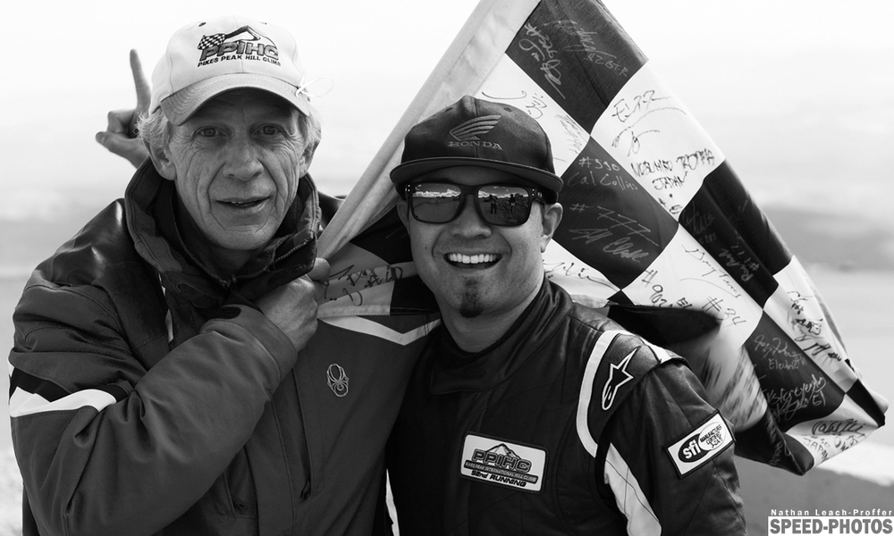 Flag signing at the 2014 Pikes Peak International Hill Climb winner - Speed-Photos.com