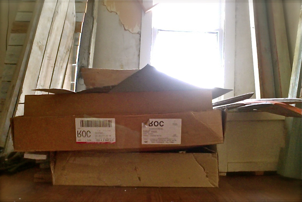 Three boxes of abandoned drawings, prints, and paintings compiled over years of demos, proofs, and material tests.
