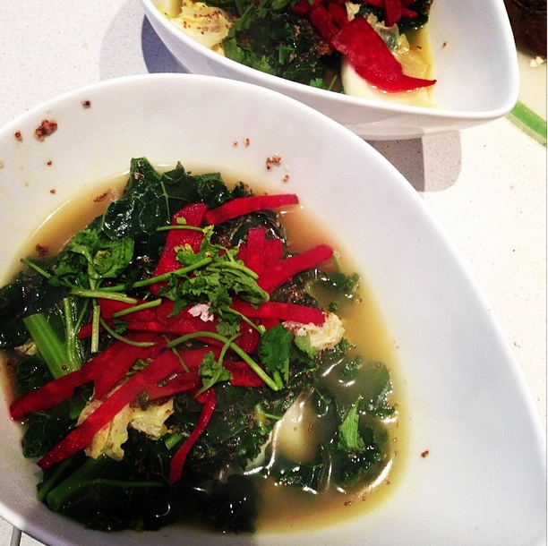 Beautiful winter soup for breakfast. Broth with quinoa kale cabbage raw beetroot turmeric and ginger.