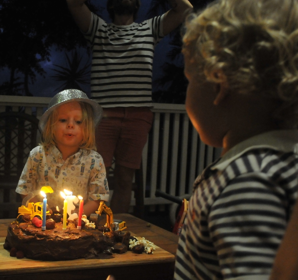 Everyone has a turn at blowing out the candles.