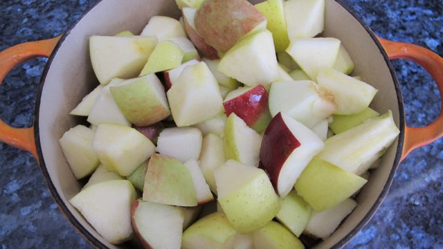 chunks of apple cooking for applesauce