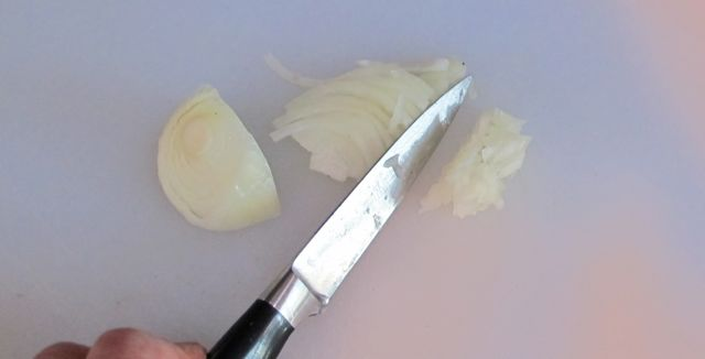 chopping onion for guacamole