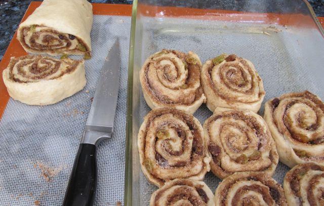 cutting the cinnamon rolls