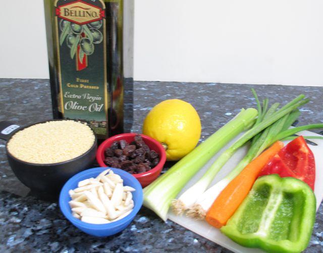 olive oil, lemon, cous cous, couscous, carrot, celery, green pepper, raisins, almonds