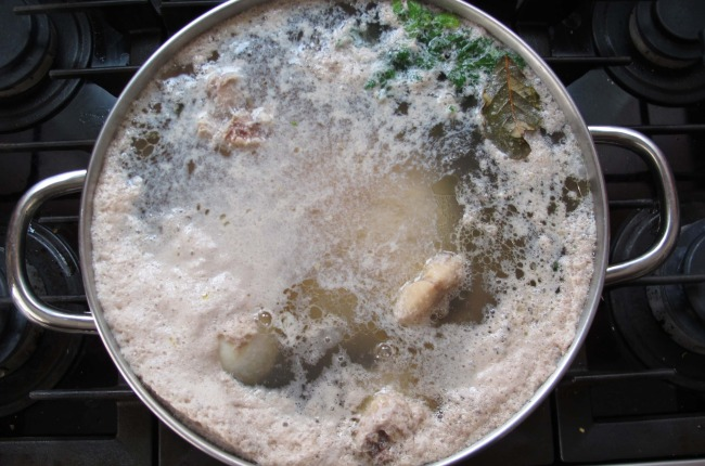 skimming foam off of chicken soup