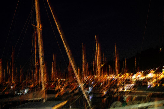 Photoshop altered nighttime photo of boats in a Seattle marina