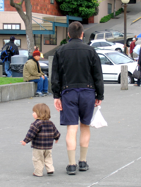 Photo of a tiny boy and a man in Seattle.