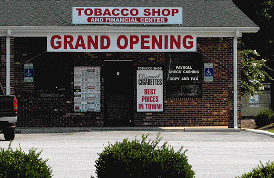 Photo of building with sign that reads Tobacco Shop and Financial Center