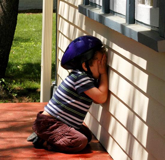 Photo of my 4 year old nephew playing hide-and-seek in his bicycle helmet