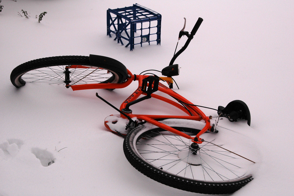 crate-and-orange-bicycle-in-snow.jpg