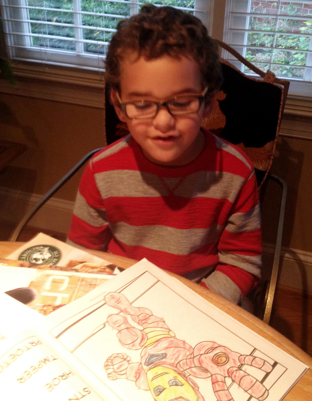 Rami likes to color super heroes. And he is working out the details of his new band. I did not know until today that he wanted a band. Or in fact, that he even knew the names of any bands. It seems I have some adjusting to do.