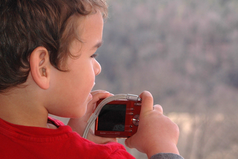little-boy-taking-picture-with-red-camera.jpg