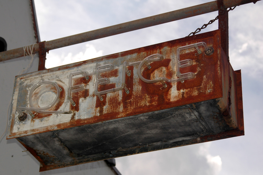 rusty-office-sign-abandoned-motel-2.jpg