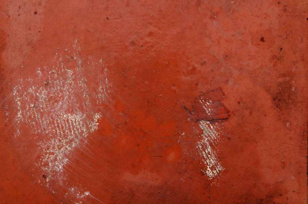 Close up of a wet, clay tile waiting to be reused in remodeling project.