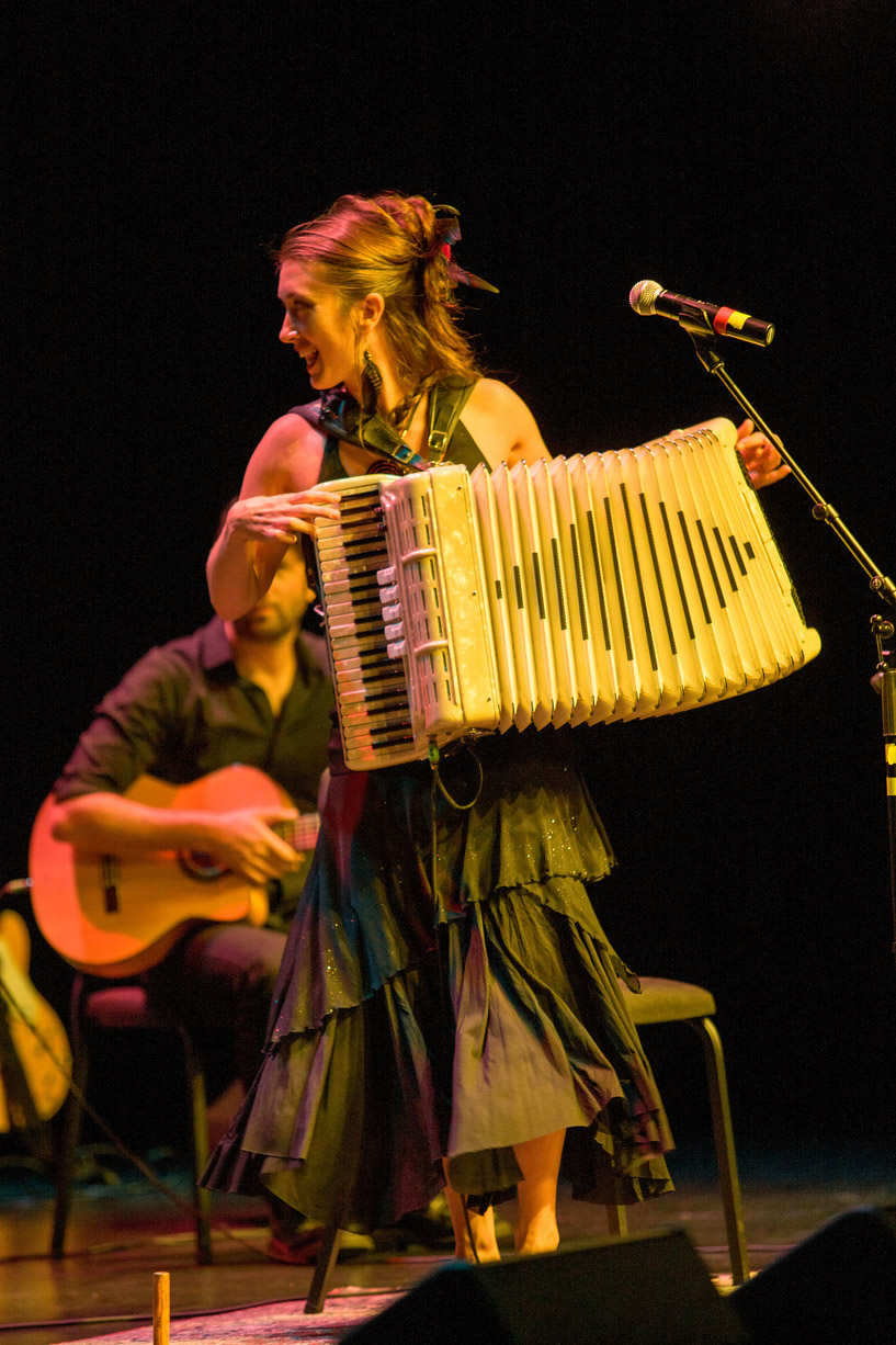 Crystal Bright on stage with accordion. Photo by Monty Chandler