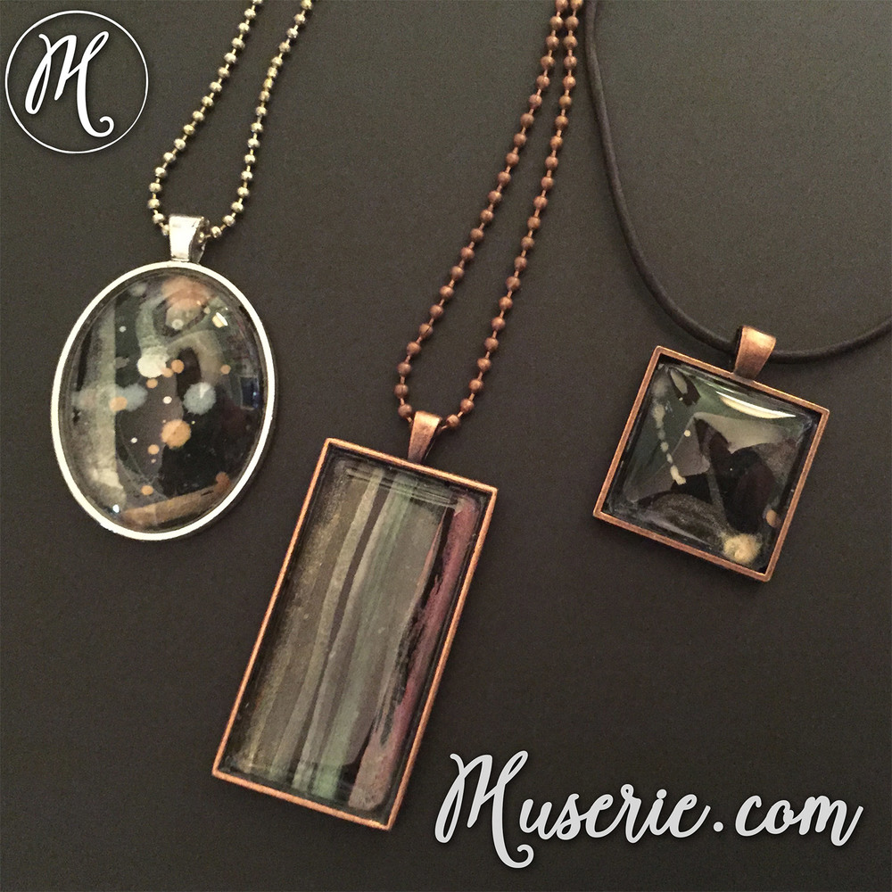 three-pearlescent-watercolor-abstract-pendants-on-black-in-copper-and-silver-tone-frames-by-muserie-artisan-jewelry-by-melody-watson-web.jpg