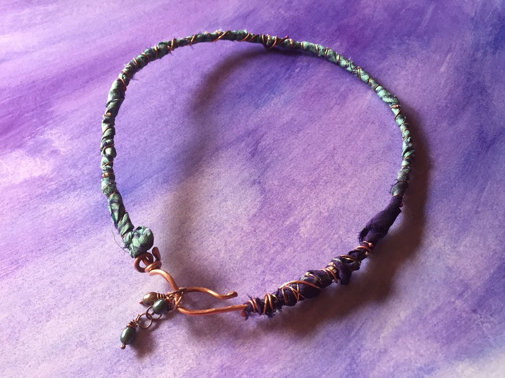 Choker necklace made from copper, silk and freshwater pearls.