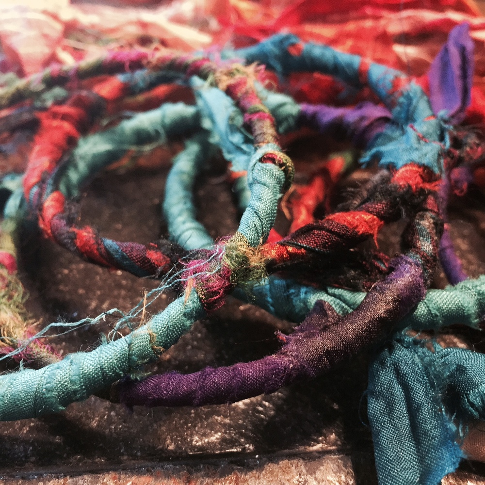 Probably more than a year ago, I started making these sari-ribbon-wrapped bracelets.