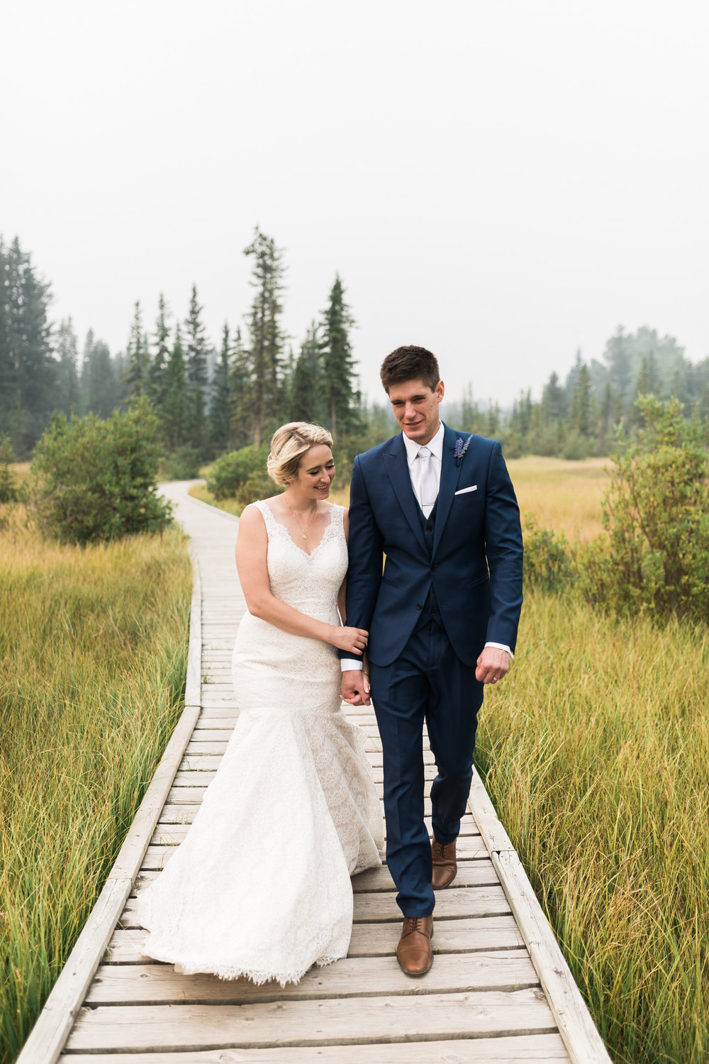 Wedding couple walking in Canmore