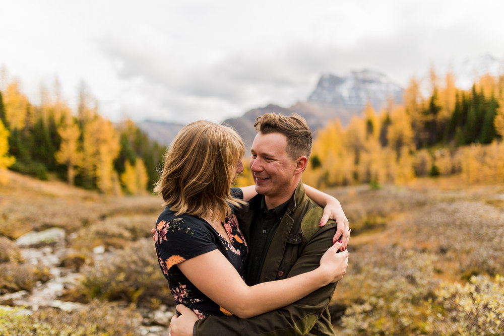 Happy adventurous engagement in Larch Valley
