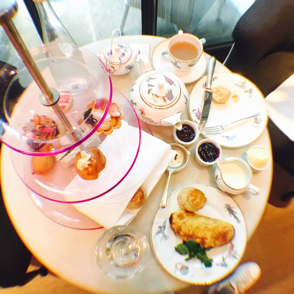 I'm not really a girly-girl but even I had to admit the transparent pink tray and prancing mythical creatures printed on the gold-rimmed ceramic plates and teacups were pretty darn cute.