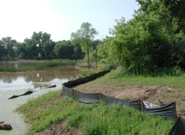 Silt fence is often installed around wetlands to protect them during construction. Areas within or below silt fence may be wetlands or other critical areas needing protection.