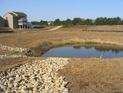 A stormwater pond collects runoff from large impervious surfaces such as roofs, roads, parking lots.