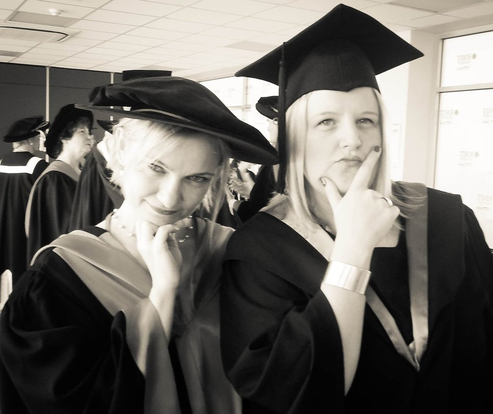 Fiona Wiebusch (right), pondering the quest to achieve a floppy hat (for PhDs) at the RMIT Graduation 2012.