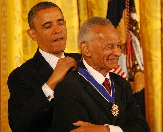 President Obama awarding Rev. CT Vivan the Presidential Medal of honor.