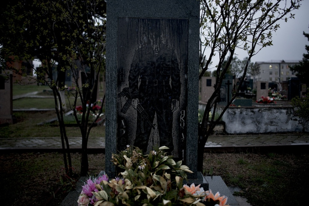 Rain covers the grave of a soldier killed in the Karabakh war, in the memorial cemetery of Stepanakert, capital of Nagorno Karabakh.