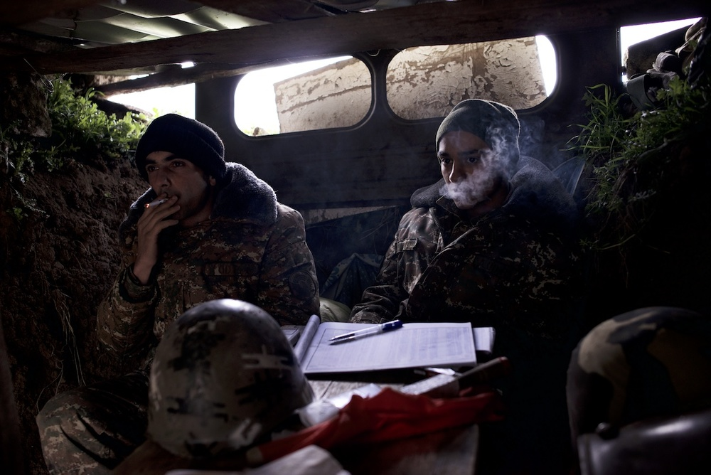 Lieutenant Vahe Avanesyan, 27, and soldier Harut Gasparyan,19, in a trench at a frontline post after an order to hide, during military operations at the frontline on April 4.