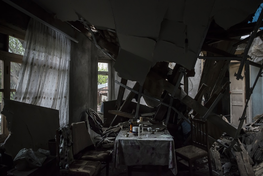 The house of Hermine Sahakyan, 30, and her family in Talish village, was hit twice during the five-day war. Shelling destroyed her children's bedroom on April 2, and another one ruined the living room on April 5. The family escaped the house in the night of April 2, several hours before the first shell hit it.