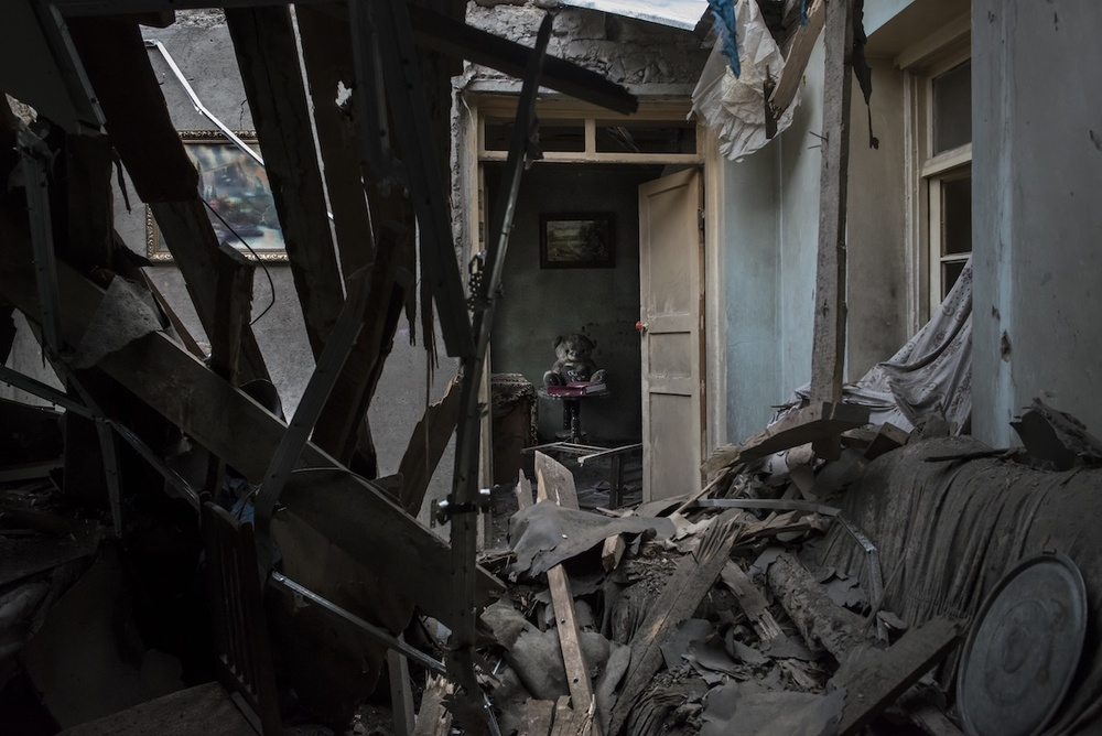 With furniture and toys covered with dirt and dust, one of the destroyed houses in the Talish village belongs to the Sahakyan family. The parents with three children and their grandmother, escaped the house the night when shootings began in the direction of the village.