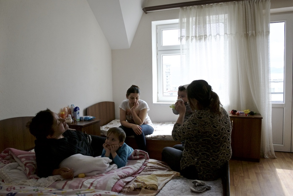 The family of Hermine Sahakyan, 30, (in the center of the frame) receives free accommodation and food at a hotel in Stepanakert. Her family house in Talish village was destroyed by shells.