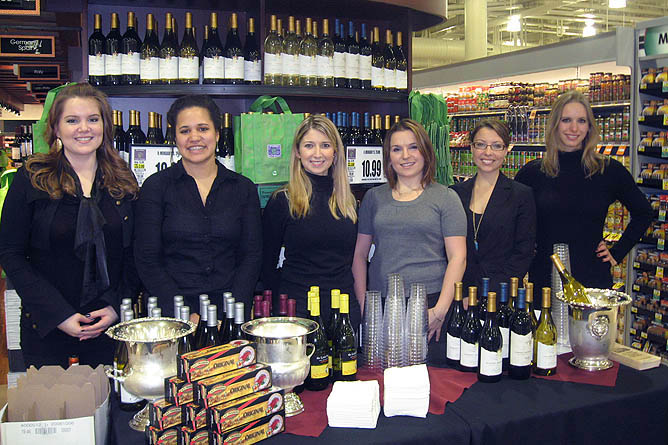 Beauté promoting wine at a Harris Teeter Grand Opening
