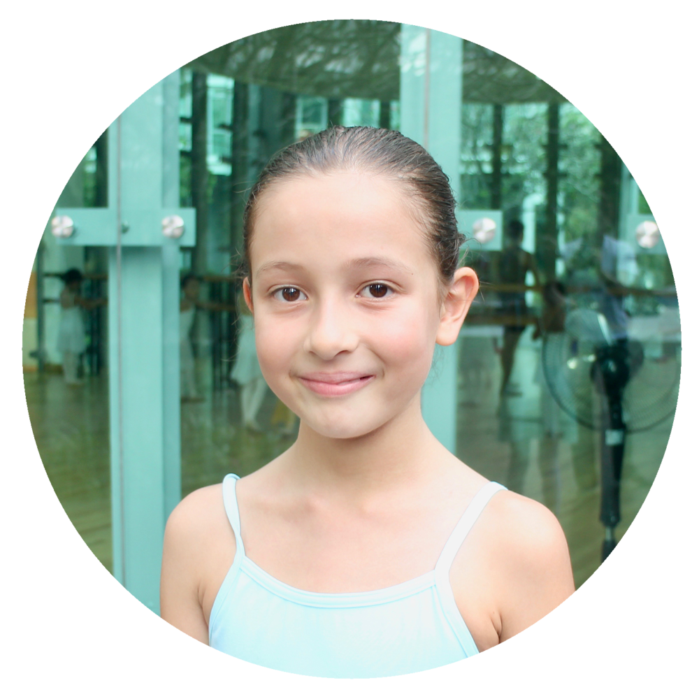 Sofia Baj   - I love ballet because I enjoy the music, singing with the ballet movements and dancing with all my friends! I get to learn a lot of dance positions and steps. I am more flexible and I can do a split now!!