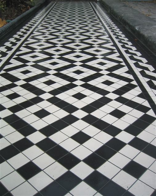 Black & white victorian   path tiles  using banded box design and wave border.