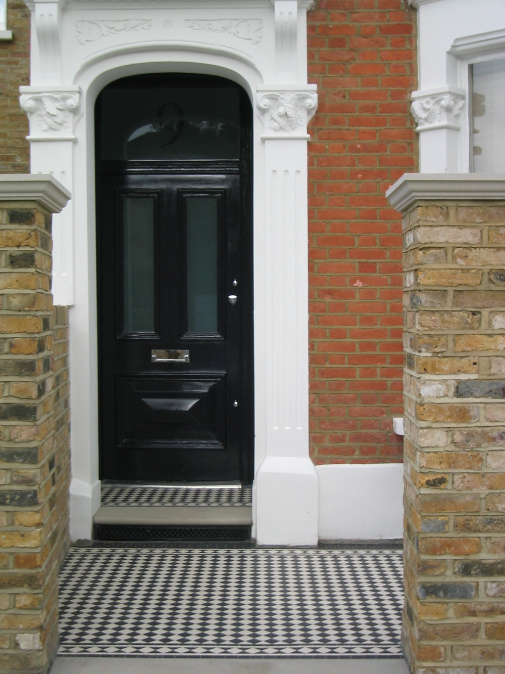 Another example of a White Diamond Border surrounding a black and white mosaic path in 5cm format.