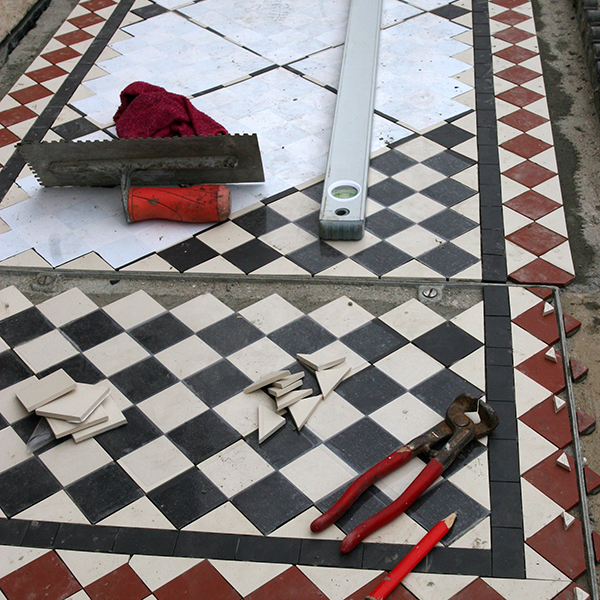 Download our step-by-step Guide - The mosaic panels are laid onto a trowelled bed of cement and the transparent film is easily removed once the cement is set.Triangles are included with the chequer patterns to finish the edges - this saves the tiler's time cutting mosaics on site.The outer finishing edge of the mosaic pathway or hallway will usually require black tiles to be cut to fit. Your tiler can do this or we can supply for a small extra cost. You will find all the information and materials list you need in our helpful guide.