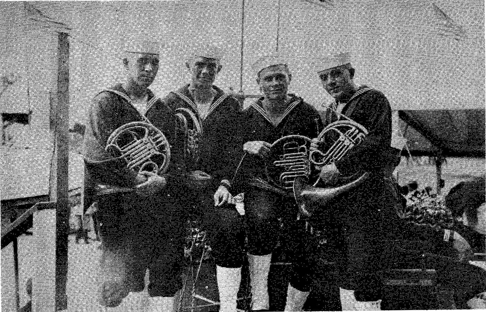Horn Section of Orchestra at Great Lakes Naval Training Station G [At Horse Show in Chicago, 1918] L. to R. - George Matz, Theodore [Ted] Stass, Wendell Hoss, Emilio Stango