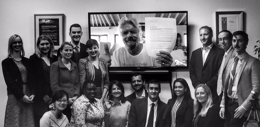 FORUM ATTENDEES pose with sir richard branson, who holds the letter addressed to delegates of cop21 . photo courtesy of the world forum on natural capital.