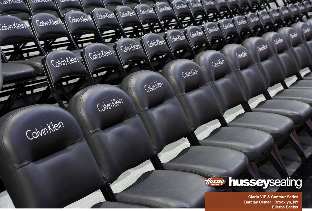Clarin by HusseySeating VIP sideline chairs customized with the Calvin Klein logo