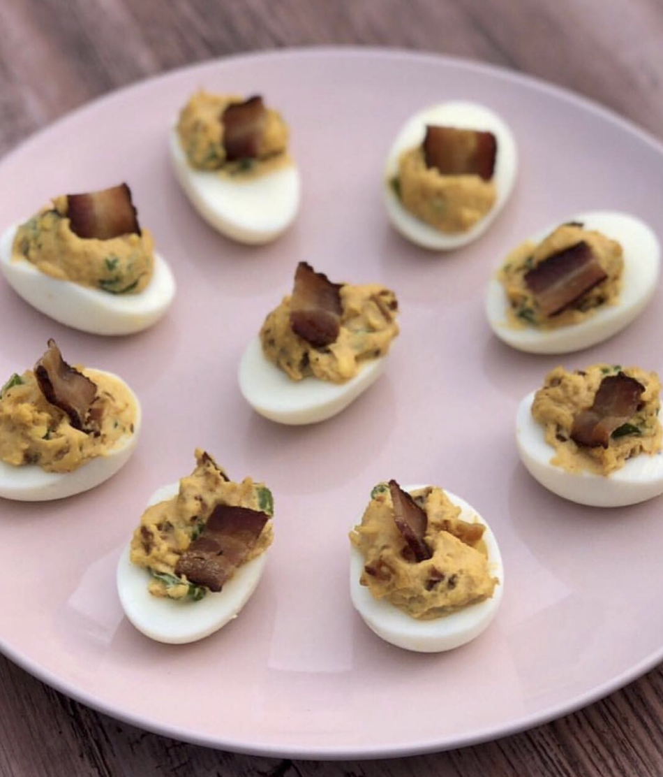 """Coach Jaclyn's Chipotle Naked Bacon Deviled Eggs are always a hit! Get the full recipe on the  """"Cooking with Sas""""  section of her blog."""