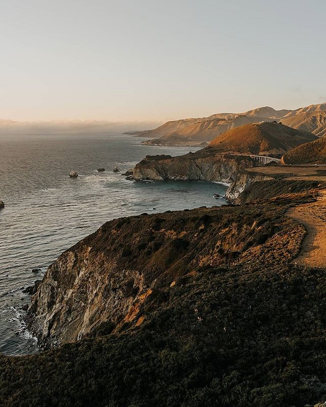 Sunset at Bixby Bridge in Big Sur, California • • • • • #westcoast #moodygrams #travelphotography #goldenhour #justgoshoot #thevisualscollective #awesupply #vscocam #fullframe #theIMAGED #artofvisuals #exklusive_shot #agameoftones #visualsoflife #bigsur #feedbacknation #neverstopexploring #surfphotography #eastcoastcreatives #thevisualscollective #awesupply #fog #bevisuallyinspired #bigsur #perfecttiming #weddingphotography #eclectic_shotz #folkgreen #earthfocus #bixbybridge