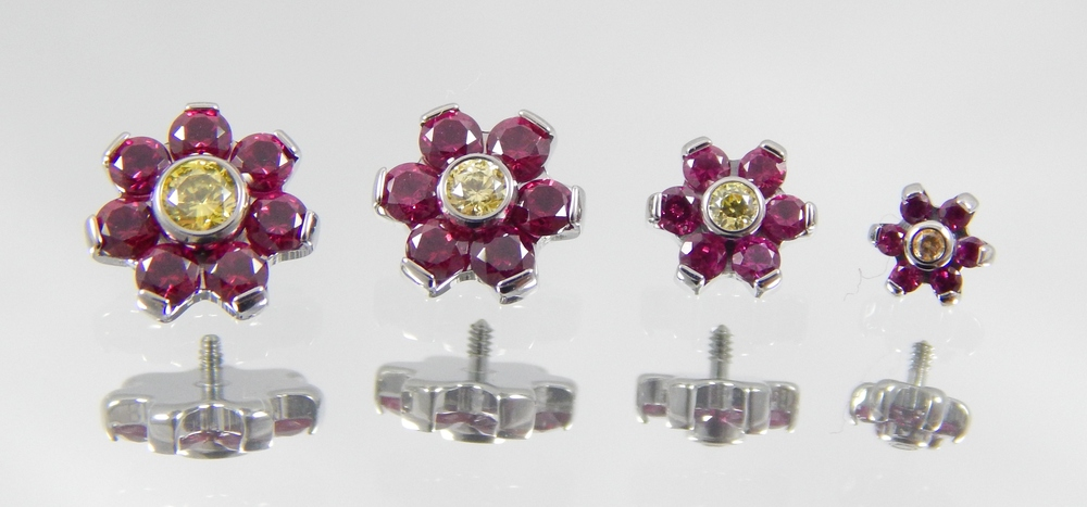 dark ruby conundrum & yellow sarovski cz's (4mm flower has amber cz center)