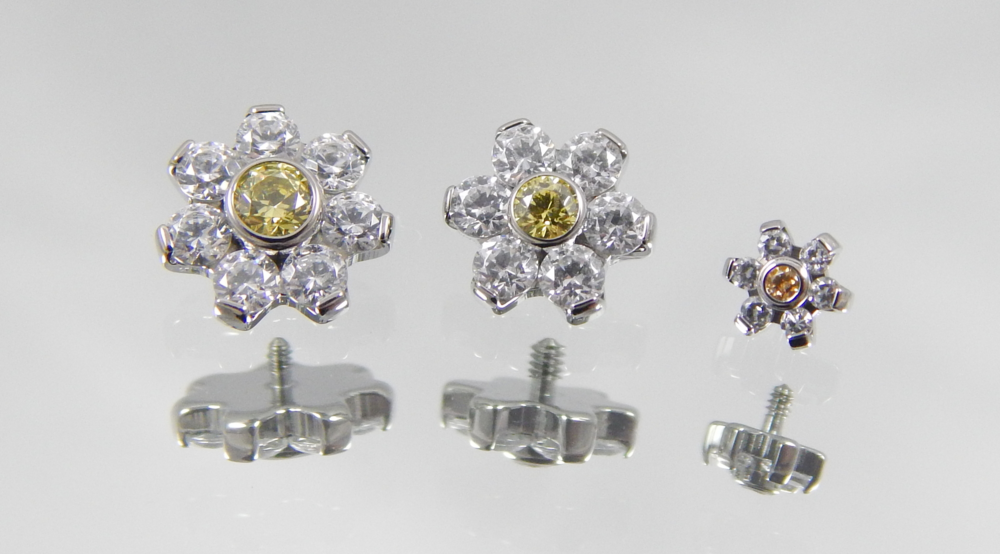 white & yellow swarovski cz's (4mm flower has amber cz center)