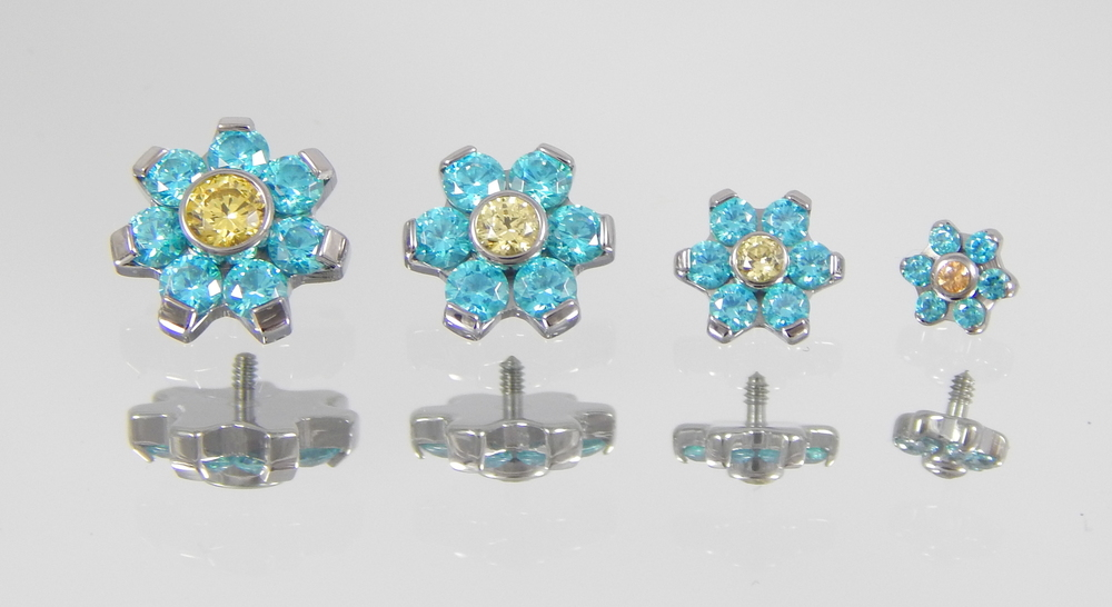 mint green & yellow swarovski cz's (4mm flower has amber cz in center)
