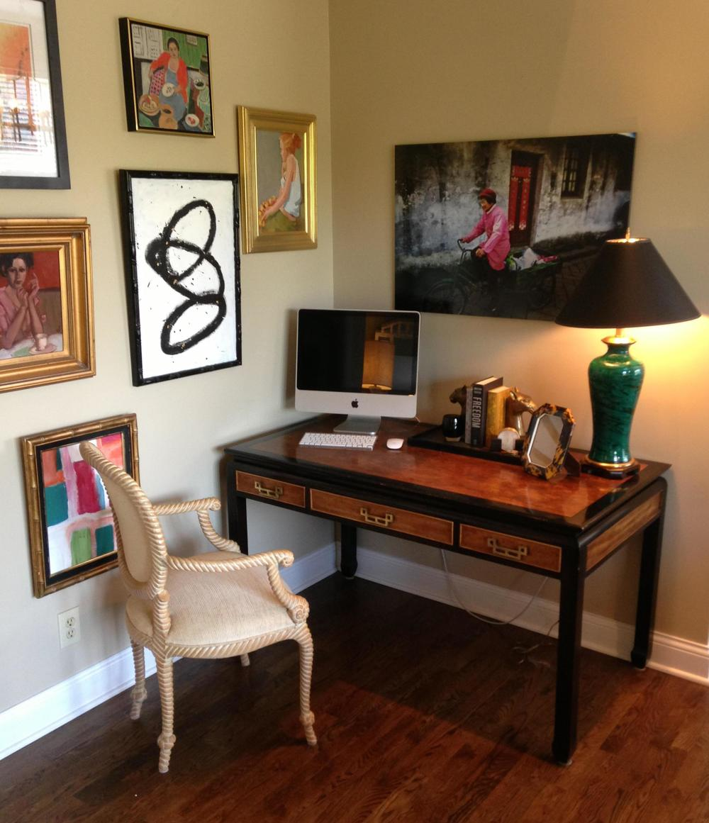 The vintage desk, chair and lamp combined with personal pieces and favorite artwork make the formerly underutilized corner of a family room come alive.