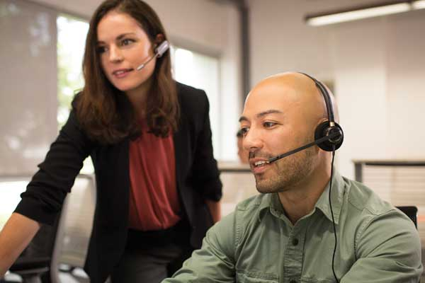 EncorePro_520_call_center_workers_talking.jpg